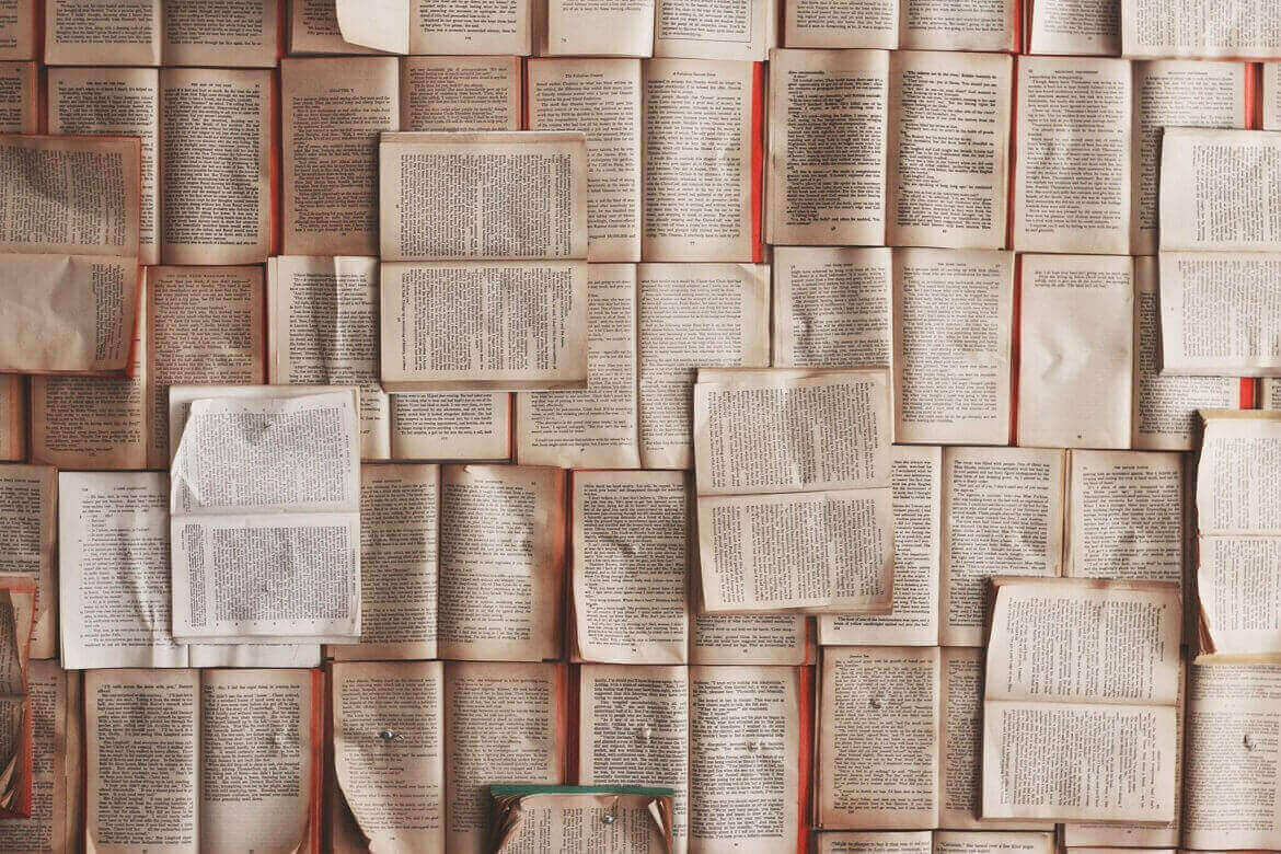 A photo of a number of pages from books on the wall representing mind mapping history